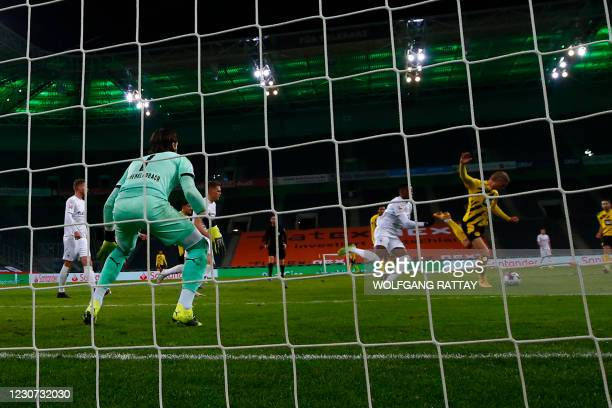 Dortmund's Norwegian forward Erling Braut Haaland scores his team's second goal against Moenchengladbach's Swiss goalkeeper Yann Sommer during the...