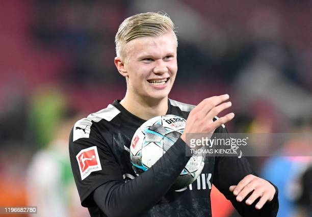 Dortmund's Norwegian forward Erling Braut Haaland smiles after his team's 5-3 victory at the end of the German first division Bundesliga football...