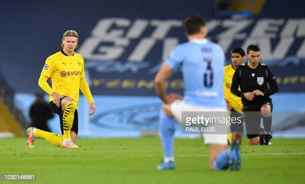 Dortmund's Norwegian forward Erling Braut Haaland takes the knee in support of the No Room For Racism campaign during the UEFA Champions League first...