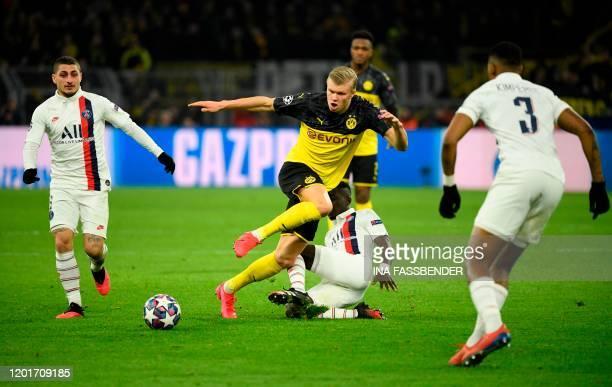 Dortmund's Norwegian forward Erling Braut Haaland vies for the ball with Paris Saint-Germain's Senegalese midfielder Idrissa Gueye , Paris...