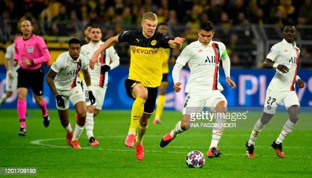 Dortmund's Norwegian forward Erling Braut Haaland vies for the ball with Paris Saint-Germain's Brazilian defender Thiago Silva during the UEFA...