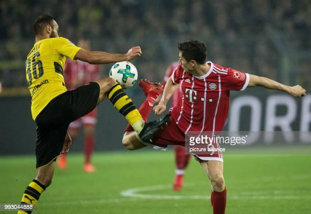 Dortmund's Oemer Topak and Bayern's Robert Lewandowski in action during the German Bundesliga soccer match between Borussia Dortmund and Bayern...