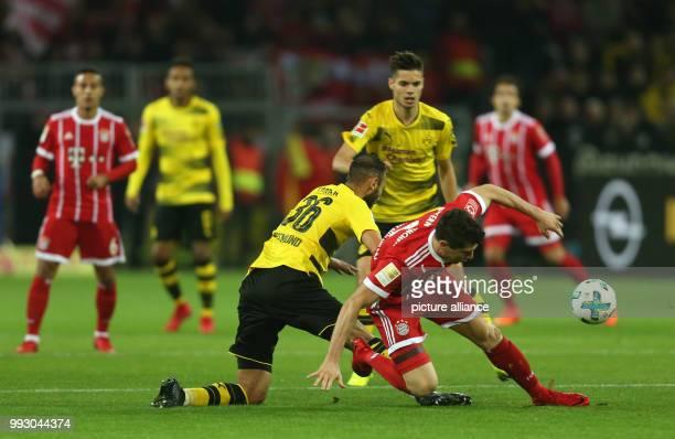 Dortmund's Oemer Toprak and Bayern's Robert Lewandowski in action during the German Bundesliga soccer match between Borussia Dortmund and Bayern...