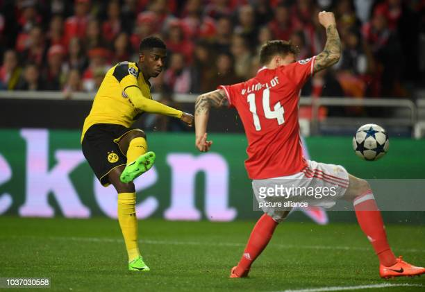 Dortmund's Ousmane Dembele and Benfica's Victor Lindeloef vie for the ball during the Champions League round of sixteen soccer match between Benfica...