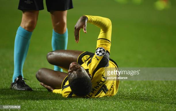 Dortmund's Ousmane Dembele lies injured during the Champions League round of sixteen soccer match between Benfica Lissabon and Borussia Dortmund at...
