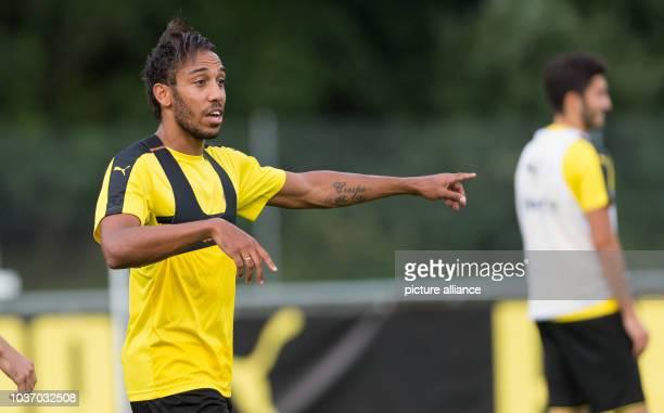 Dortmund's Pierre-Emerick Aubameyang gives instructions at the training camp in Bad Ragaz, Switzerland, 4 August 2016. PHOTO: GUIDO KIRCHNER/dpa |...