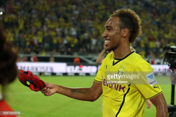 Dortmund's PierreEmerick Aubameyang receives a spiderman mask after the super cup match between Borussia Dortmund and FC Bayern Munich at...