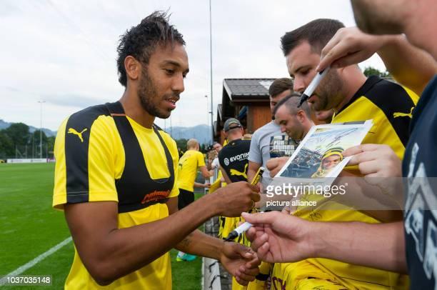Dortmund's Pierre-Emerick Aubameyang signing autographs after training in Bad Ragaz, Switzerland, 4 August 2016. PHOTO: GUIDO KIRCHNER/dpa | usage...