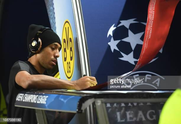 Dortmund's PierreEmerick Aubameyang signs autographs before the Champions League soccer match between Benfica Lissabon and Borussia Dortmund at the...