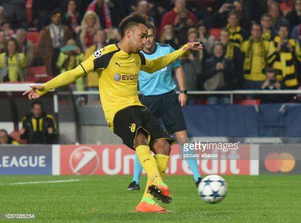 Dortmund's PierreEmerick Aubameyang takes a penalty kick during the first leg of the Champions League quarter final knockout match between the...