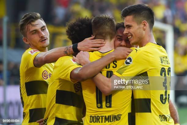 Dortmund's players celebrate after scoring during the German first division Bundesliga football match Borussia Dortmund vs Bayer Leverkusen in...