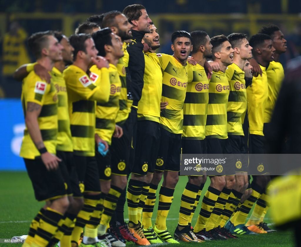 Dortmund's players celebrate after the German First division Bundesliga football match Borussia Dortmund vs Borussia Moenchengladbach in Dortmund, western Germany, on September 23, 2017. /