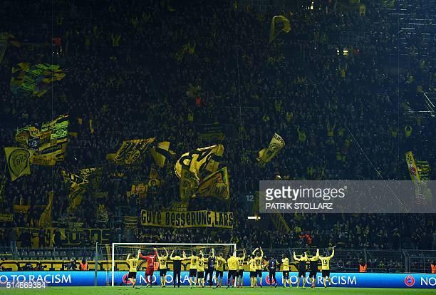 Dortmund´s players celebrate after winning the UEFA Europe League Round of 16 first leg football match between Borussia Dortmund and Tottenham...