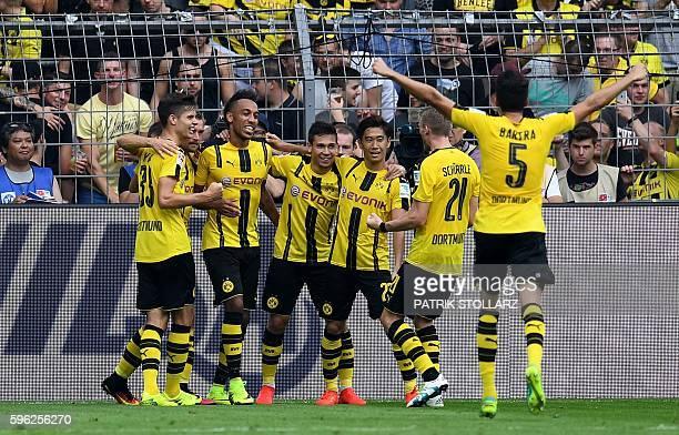 Dortmund's players celebrate during the German first division Bundesliga football match of Borussia Dortmund vs FSV Mainz 05 in Dortmund western...