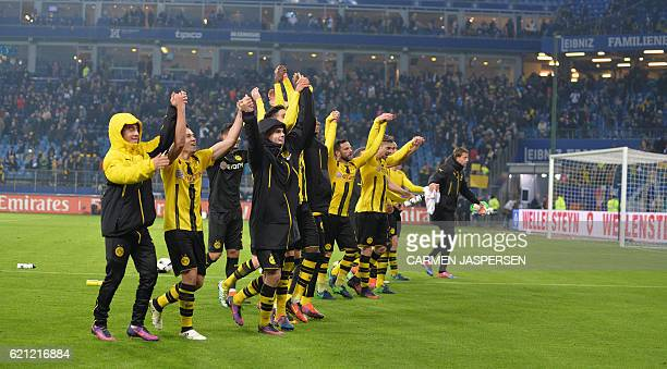 Dortmund's players celebrate fter the German first division Bundesliga football match between Hamburg SV and BVB Borussia Dortmund in Hamburg...