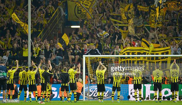 Dortmund's players celebrate in front of their fans after the UEFA Champions League semi final first leg football match between Borussia Dortmund and...
