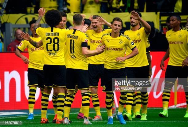 Dortmund's players celebrate scoring during the German first division Bundesliga football match BVB Borussia Dortmund v Augsburg in Dortmund western...