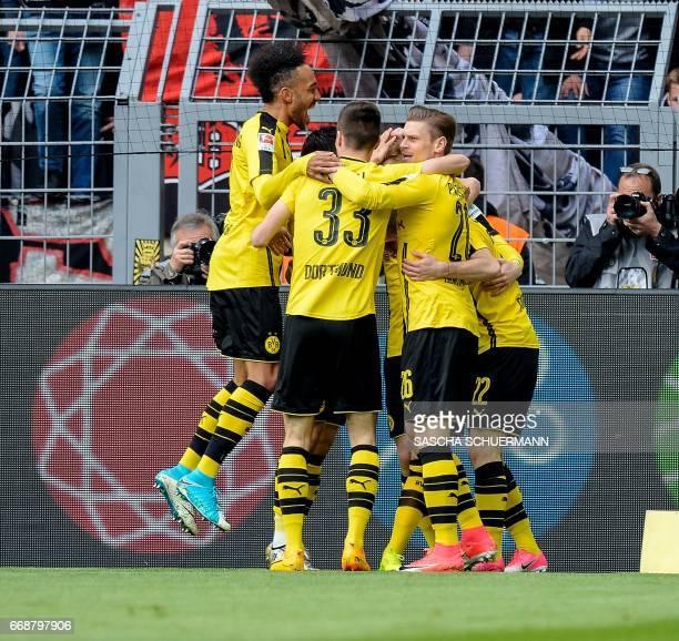 Dortmund's players celebrate scoring during the German First division Bundesliga football match between Borussia Dortmund and Eintracht Frankfurt in...