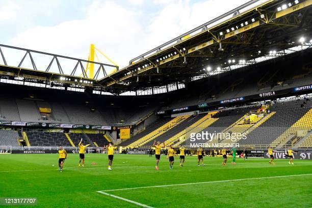 Dortmund's players celebrate their victory 40 after the German first division Bundesliga football match BVB Borussia Dortmund v Schalke 04 on May 16...