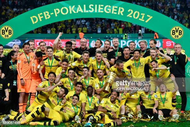 Dortmund's players celebrate with the trophy after winning the German Cup final football match Eintracht Frankfurt v BVB Borussia Dortmund at the...