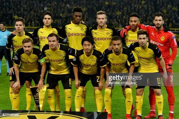 Dortmund´s players Dortmund's German defender Marcel Schmelzer Dortmund's German midfielder Mario Goetze Dortmund's Japanese midfielder Shinji Kagawa...
