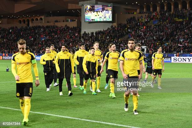 Dortmund's players leave the pitch after Monaco defeated Dortmund during the UEFA Champions League 2nd leg quarterfinal football match AS Monaco v...