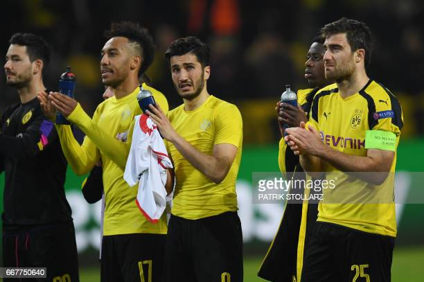 Dortmund's players react after the UEFA Champions League 1st leg quarterfinal football match BVB Borussia Dortmund v Monaco in Dortmund western...