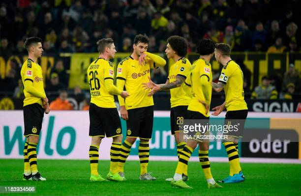 Dortmund's players react during the German first division Bundesliga football match Borussia Dortmund v SC Paderborn in Dortmund western Germany on...