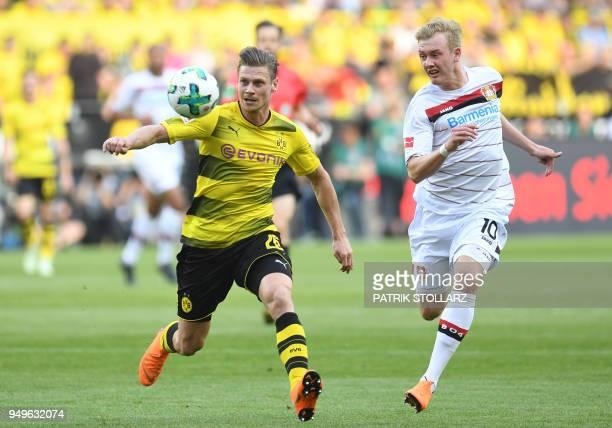 Dortmund's Polish defender Lukasz Piszczek and Leverkusen's German midfielder Julian Brandt vie for the ball during the German first division...