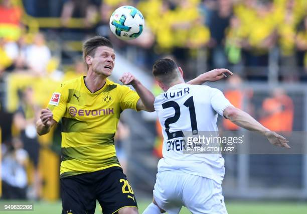 Dortmund's Polish defender Lukasz Piszczek and Leverkusen's German midfielder Dominik Kohr vie for the ball during the German first division...