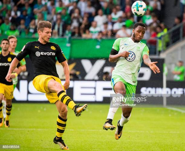 Dortmund's Polish defender Lukasz Piszczek and Wolfsburg's English forward Kaylen Hinds during the German First division Bundesliga football match...