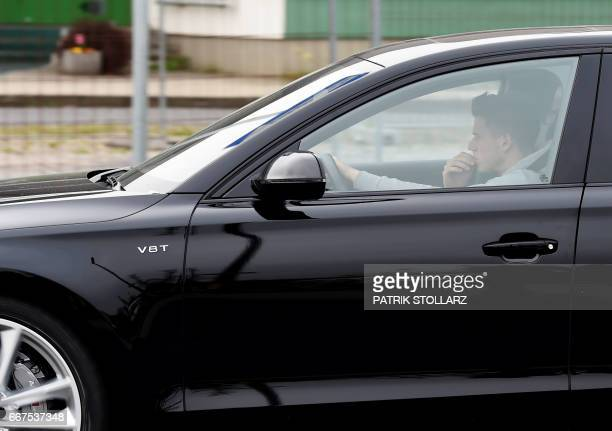 Dortmund's Polish defender Lukasz Piszczek arrives in his car at the main entrance of the Dortmund training ground in Brackel on April 12 2017 one...