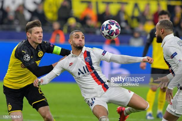 Dortmund's Polish defender Lukasz Piszczek vies for the ball with Paris SaintGermain's French defender Layvin Kurzawa and Paris SaintGermain's...