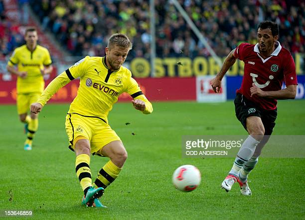 Dortmund's Polish midfielder Jakub Blaszczykowski and Hanover's midfielder Sergio Pinto vie for the ball during the German first division Bundesliga...