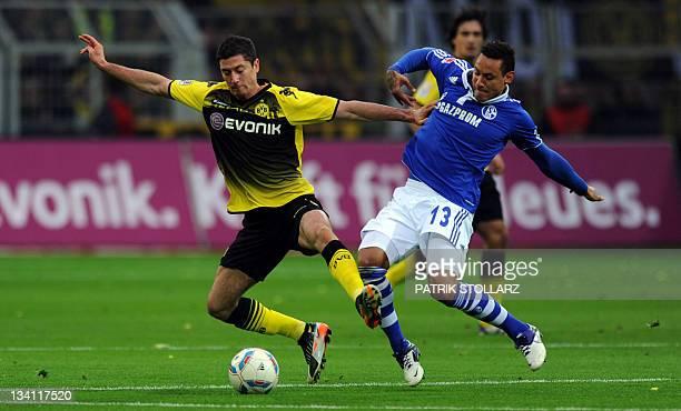 Dortmund's Polish striker Robert Lewandowski and Schalke's US midfielder Jermaine Jones vie for the ball during the German first division Bundesliga...