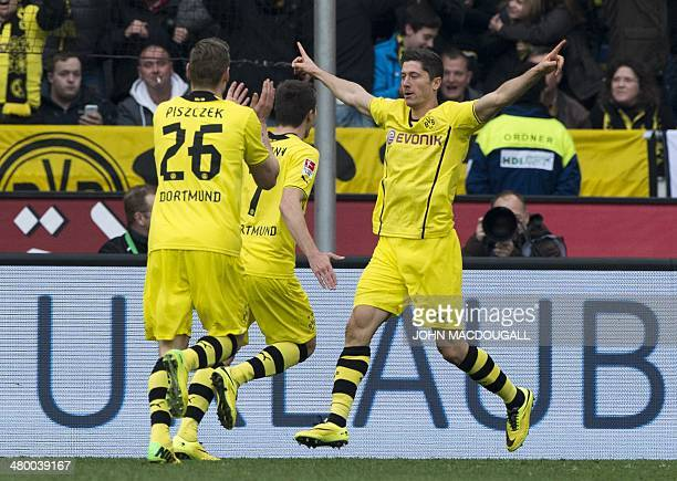 Dortmund's Polish striker Robert Lewandowski celebrates with teammates after scoring his side's second goal during the German first division...