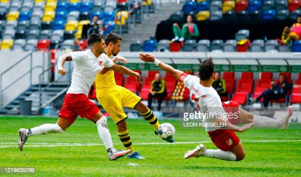 Dortmund's Portuguese defender Raphael Guerreiro scores a goal before it was ruled out by VAR during the German first division Bundesliga football...