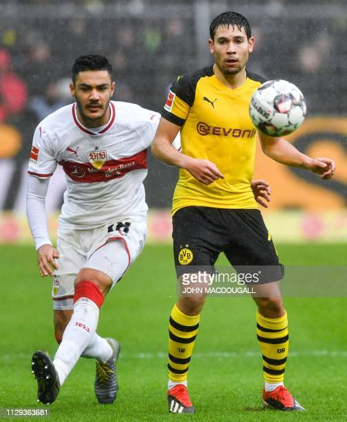 Dortmund's Portuguese defender Raphael Guerreiro vies for the ball during the German first division Bundesliga football match Borussia Dortmund vs...