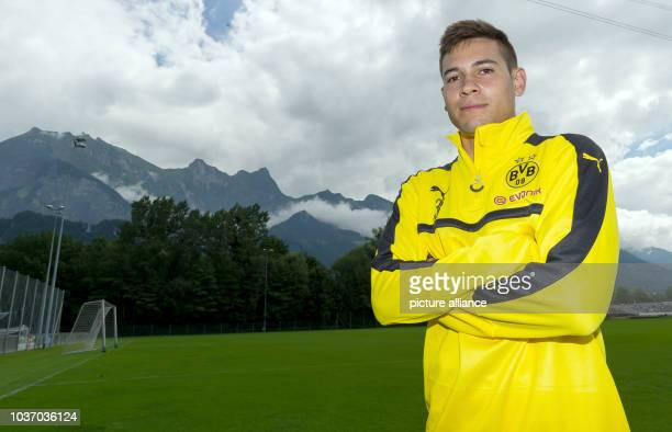 Dortmund's Raphael Guerreiro stands in front of a mountain panorama at the Borussia Dortmund training camp for the 2016/17 season in Bad Ragaz,...