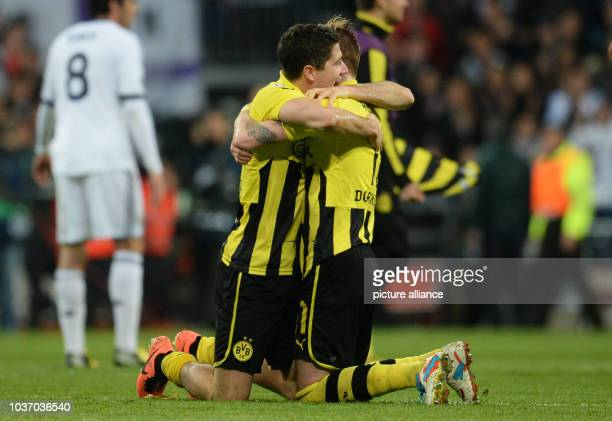 Dortmund's Robert Lewandowski and Marco Reus celebrate at the end of the UEFA Champions League semi final second leg soccer match between Borussia...