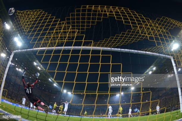 Dortmund's Robert Lewandowski scores the goal 31 against Madrid's goalkeeper Diego Lopez during the UEFA Champions League semi final first leg...