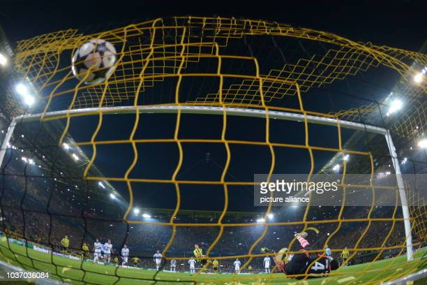 Dortmund's Robert Lewandowski  scores the goal 41 by penalty against Madrid's goalkeeper Diego Lopez during the UEFA Champions League semi final...