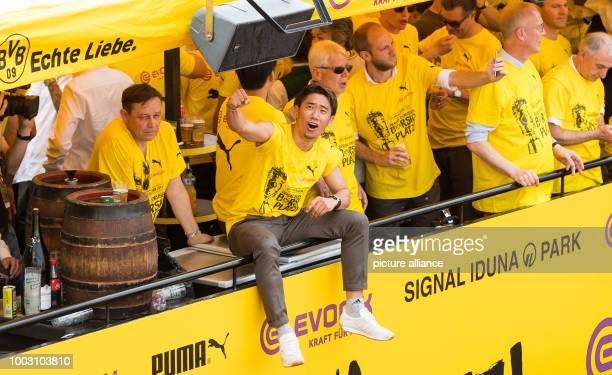 Dortmund's Shinji Kagawa celebrates aboard the team truck in Dortmund Germany 28 May 2017 Borussia Dortmund won the DFBCup final match against...