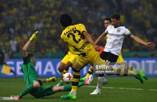 Dortmund's Shinji Kagawa in action against Frankfurt's goalkeeper Lukas Hradecky during the German DFBCup final soccer match between Eintracht...