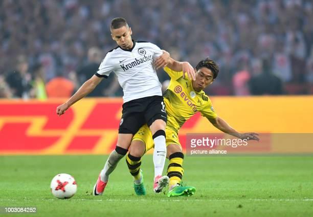 Dortmund's Shinji Kagawa in action against Frankfurt's Mijat Gacinovic during the German DFBCup final soccer match between Eintracht Frankfurt and...