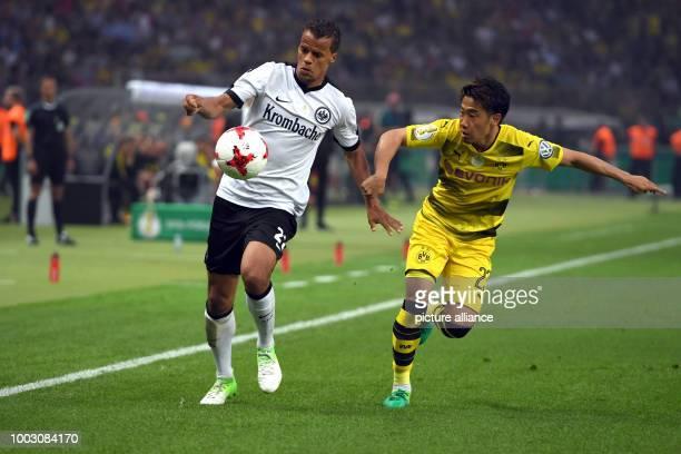 Dortmund's Shinji Kagawa in action against Frankfurt's Timothy Chandler during the German DFBCup final soccer match between Eintracht Frankfurt and...