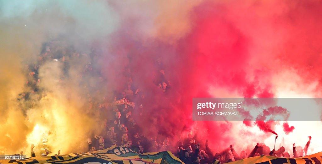 Dortmund's soccer fans use fireworks during the German first division Bundesliga football match Hertha BSC Berlin vs BVB Borussia Dortmund, in Berlin, western Germany, on January 19, 2018. / AFP PHOTO / Tobias