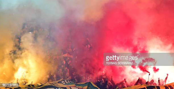 Dortmund's soccer fans use fireworks during the German first division Bundesliga football match Hertha BSC Berlin vs BVB Borussia Dortmund in Berlin...