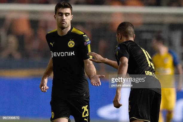 Dortmund's Sokratis Papastathopoulos celebrates the 1-1 goal with Jeremy Toljan during the Champions League group stages qualification match between...