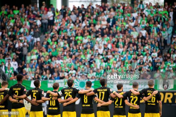 Dortmund´s Spanish defender Marc Bartra and the teams observe a minute of silence for the victims of the Barcelona attack prior to kick off for the...